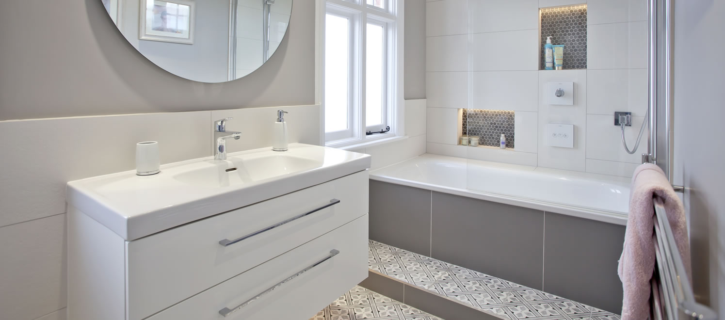 Contemporary bathroom with mosaic insets