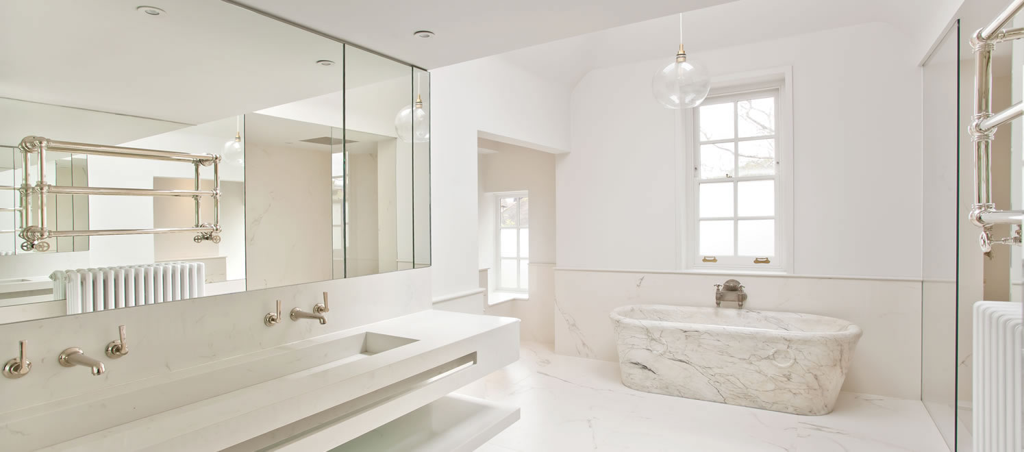 Bathroom with marble free standing bath